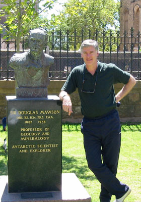 Beau Riffenburgh next to a bust of Sir Douglas Mawson in Adelaide, South Australia.